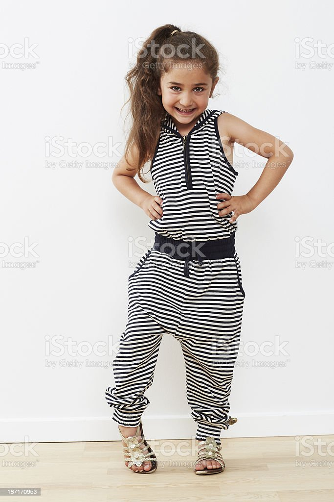 Young girl posing in jumpsuit, portrait royalty-free stock photo