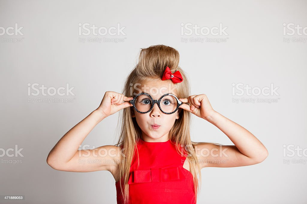 Young Girl Posing on White Background with Glasses stock photo