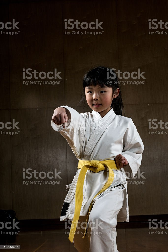 Young girl practicing karate stock photo