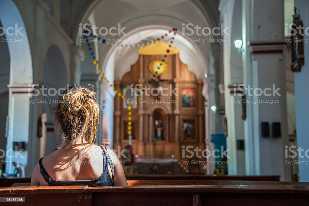 Young Girl praying in a San Cristobal Church, Traveling Mexico. stock photo