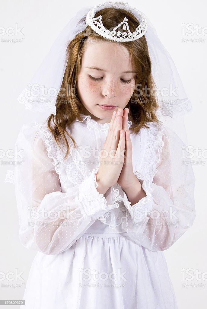 Young girl Praying in First Communion Attire stock photo