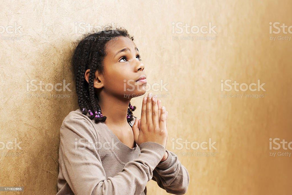Young girl praying. stock photo