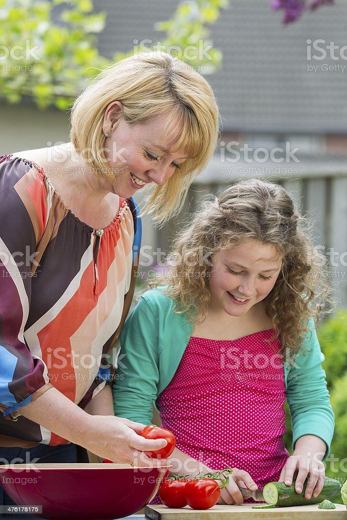 Young girl preparing food royalty-free stock photo