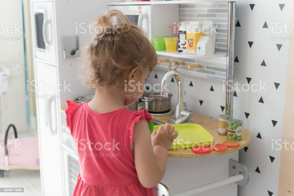 Young girl preparing lunch in the kindergarten stock photo