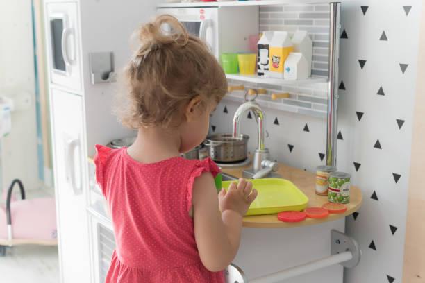 Young girl preparing lunch in the kindergarten stock photo
