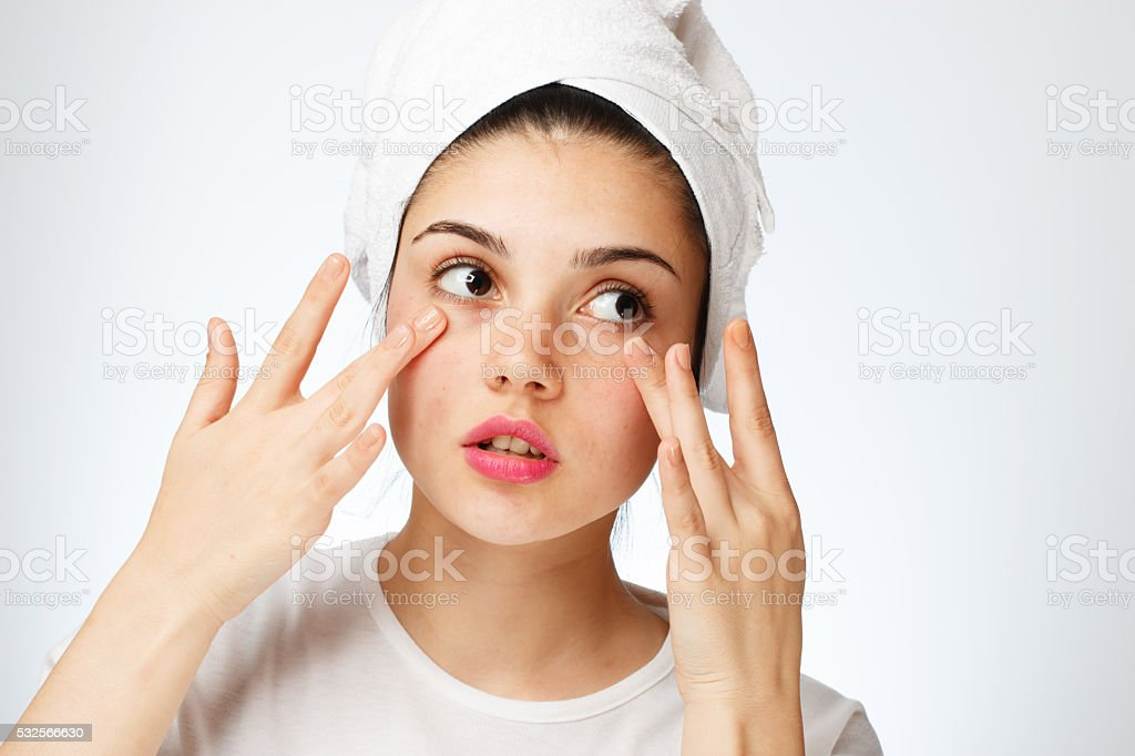 Young girl problems around the eye stock photo