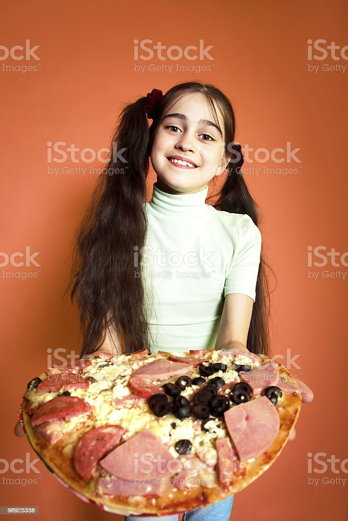 Young girl propose pizza royalty-free stock photo