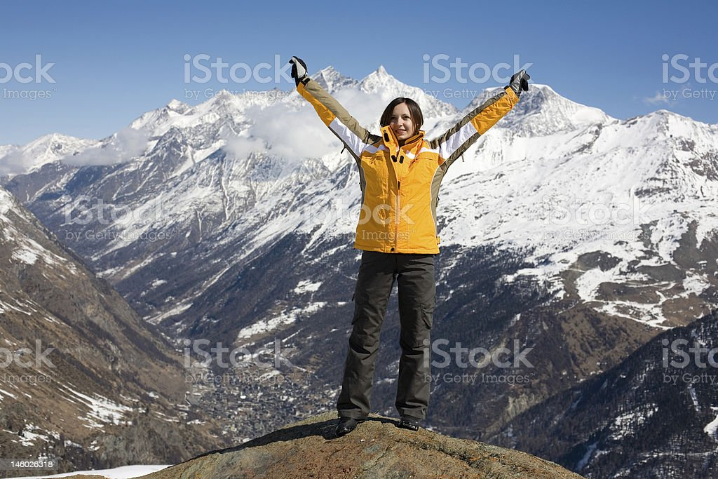 Young girl reached the top of mountain royalty-free stock photo
