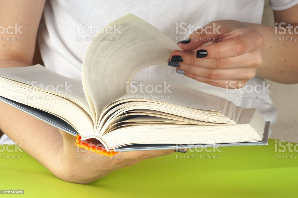 Young girl reading an open book old book. Knowledge, stock photo