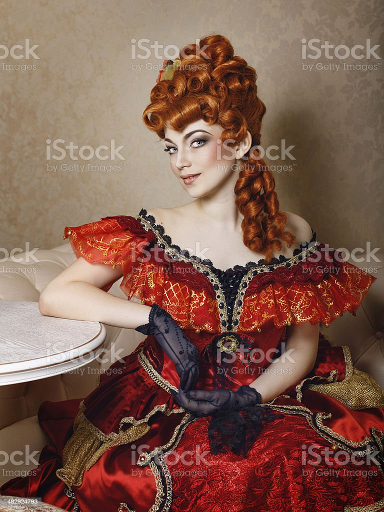 Young girl red dress stock photo