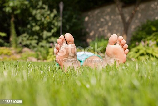 521982322 istock photo Young girl relaxing on grass 1138710088