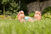 istock Young girl relaxing on grass 1138710088