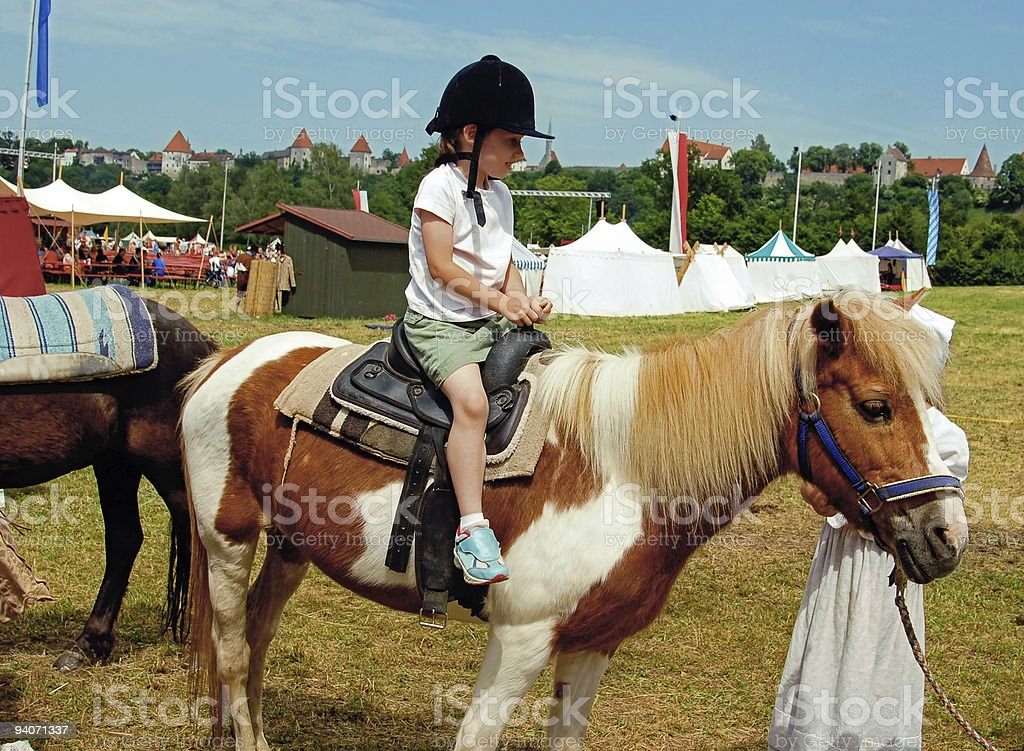 Young Girl riding a Pony stock photo