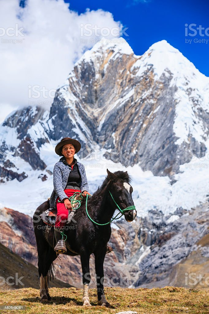 Young girl riding horse in Peruvian Andes, South America royalty-free stock photo