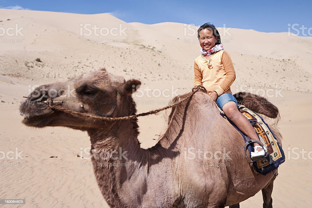 Young girl riding on the camel stock photo