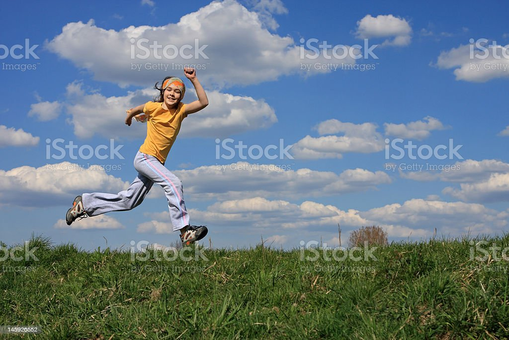 Young girl running royalty-free stock photo