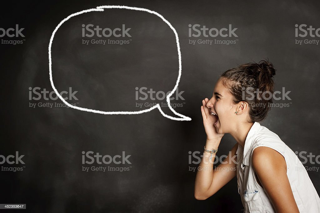 young girl screaming in front of chalkboard stock photo