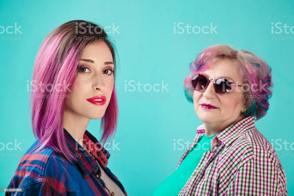 Young girl, senior woman in colorful clothes and hairstyle. Hipster - Photo