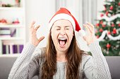 istock young girl shout because of christmas stress 618346804