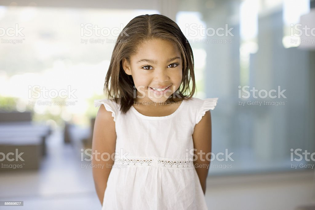 Young girl shyly smiling royalty-free stock photo
