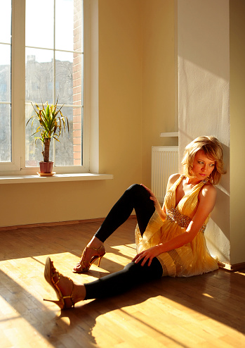 Young Girl Sit On Floor Near Window Stock Photo - Download