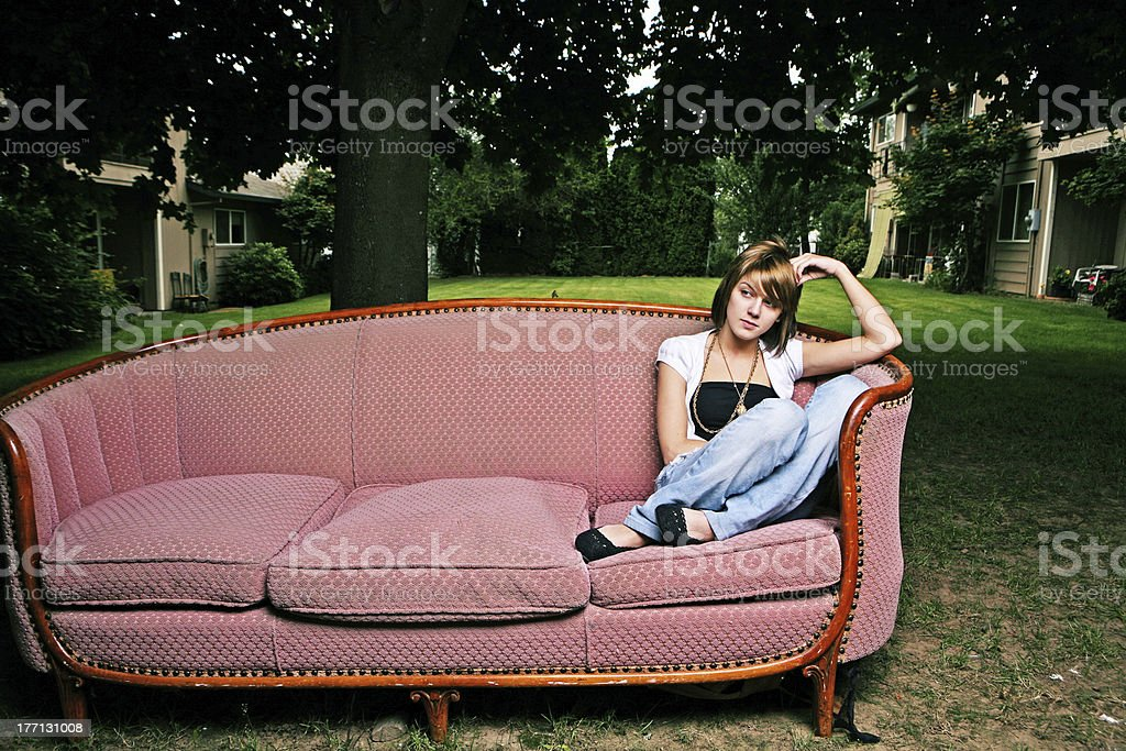 Young Girl Sitting and Thinking on a Couch royalty-free stock photo