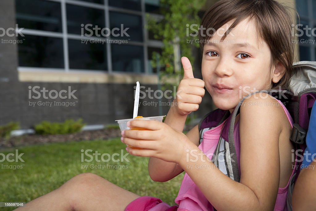 Young girl sitting at school stock photo