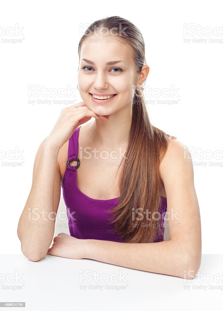 young girl sitting at table stock photo