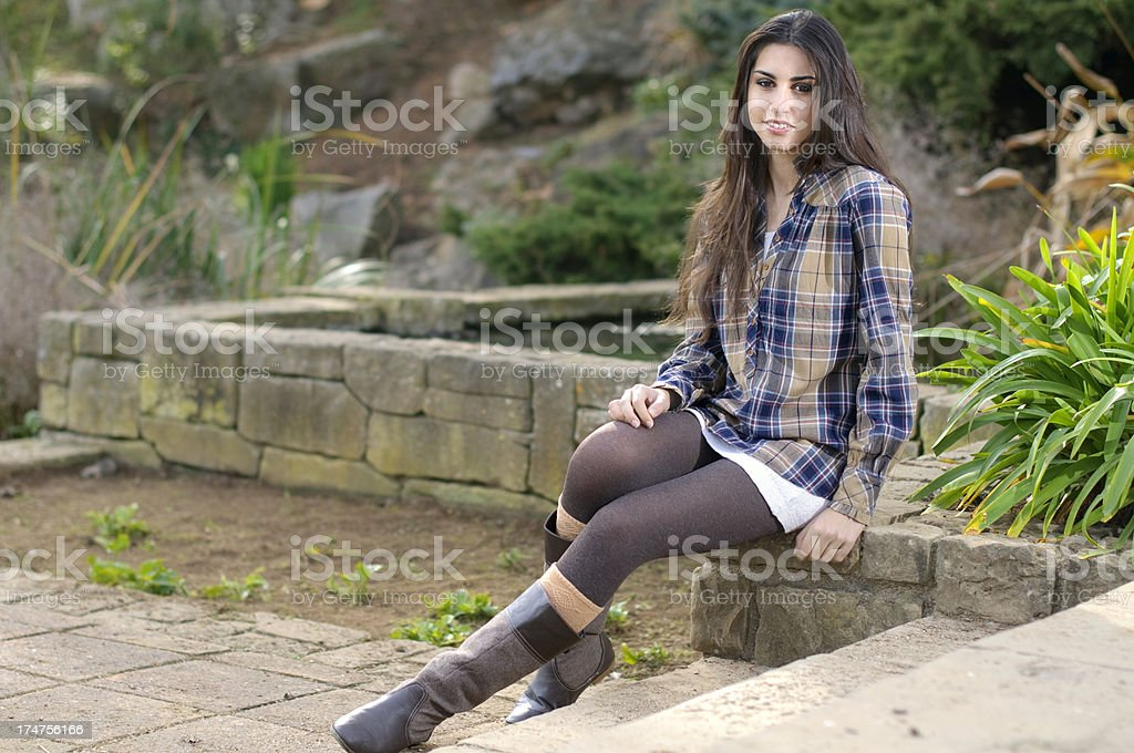 Young girl sitting in a park royalty-free stock photo