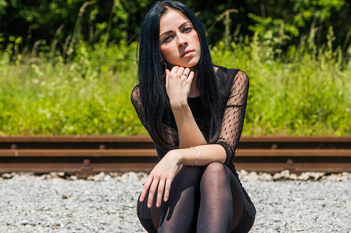 Young Girl Sitting On Rail Tracks Stock Photo - Download ...