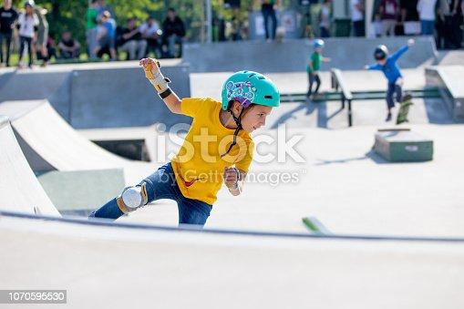 Young Girl Skateboarding in Skatepark.