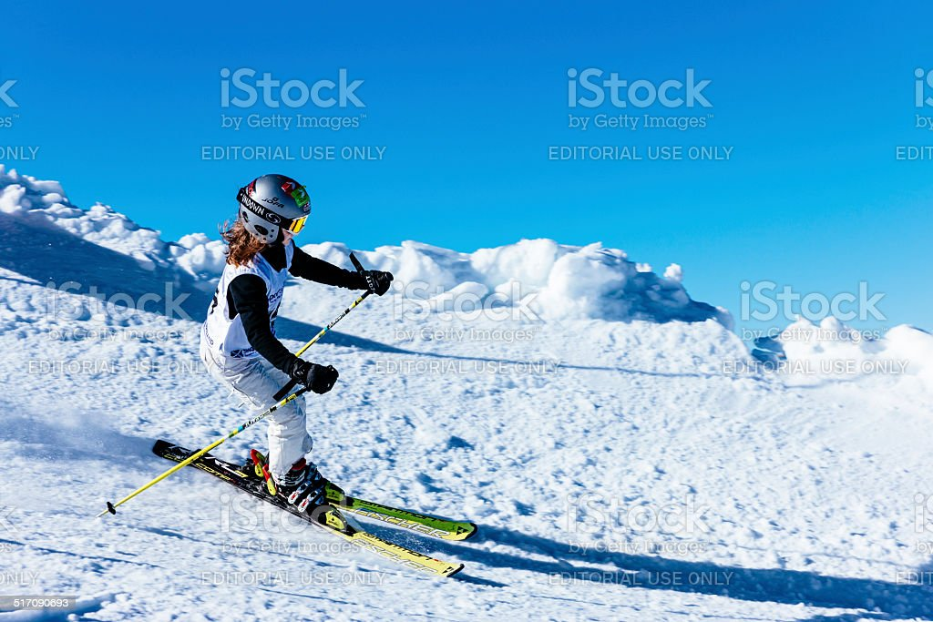 Young girl skiing on snow in competition stock photo