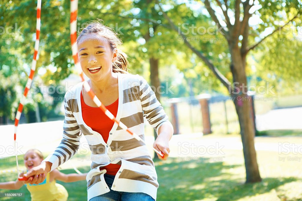 Young girl skipping stock photo
