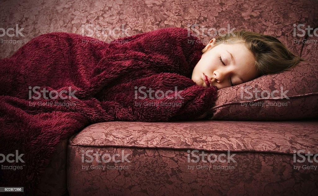 Young girl sleeping on sofa royalty-free stock photo