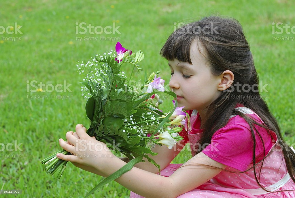 Young girl smelling flowers royalty-free stock photo