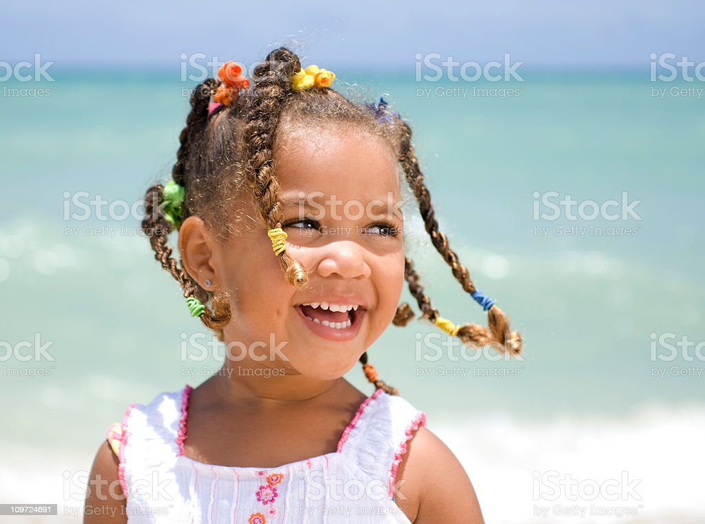 Young girl smiling at the beach royalty-free stock photo