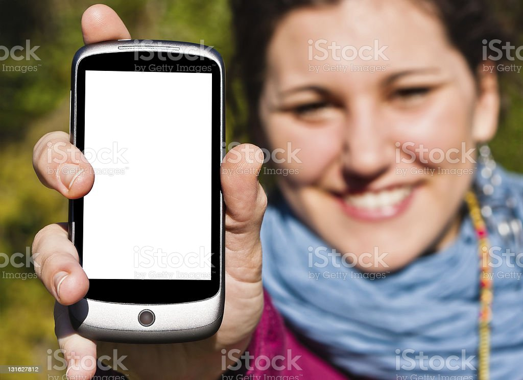 Young Girl Smiling with Blank Screen Smartphone royalty-free stock photo