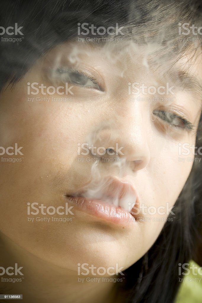 Young girl smoking royalty-free stock photo