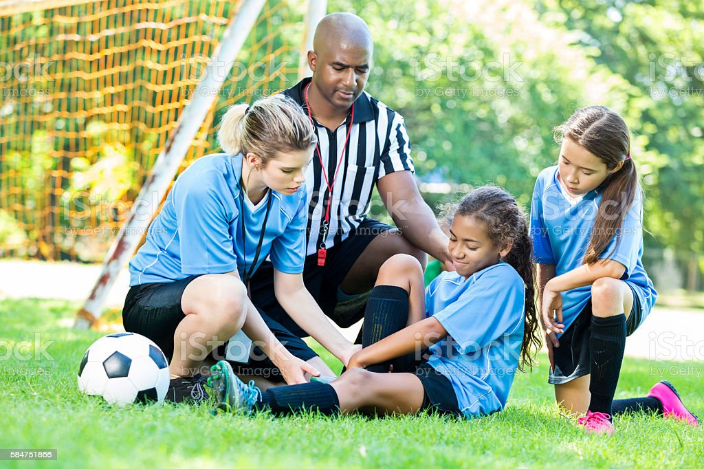 Young girl soccer player got hurt during the game stock photo