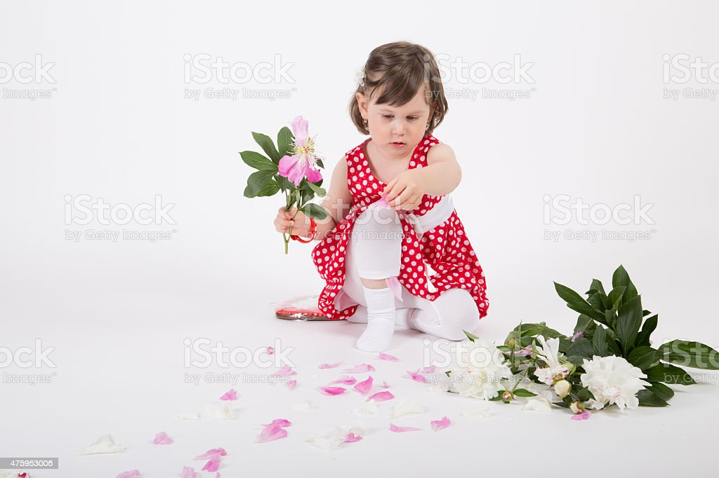 Young girl spred pink rose petal stock photo