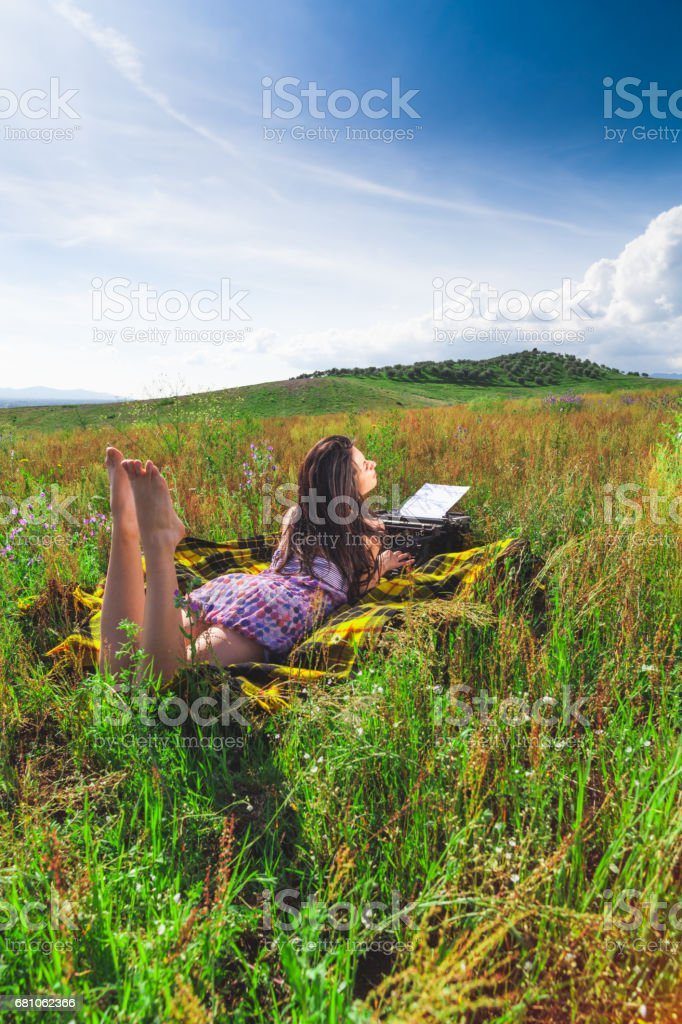 Young girl spring portrait in the grass royalty-free stock photo
