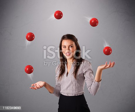 istock young girl standing and juggling with red balls 1152349693
