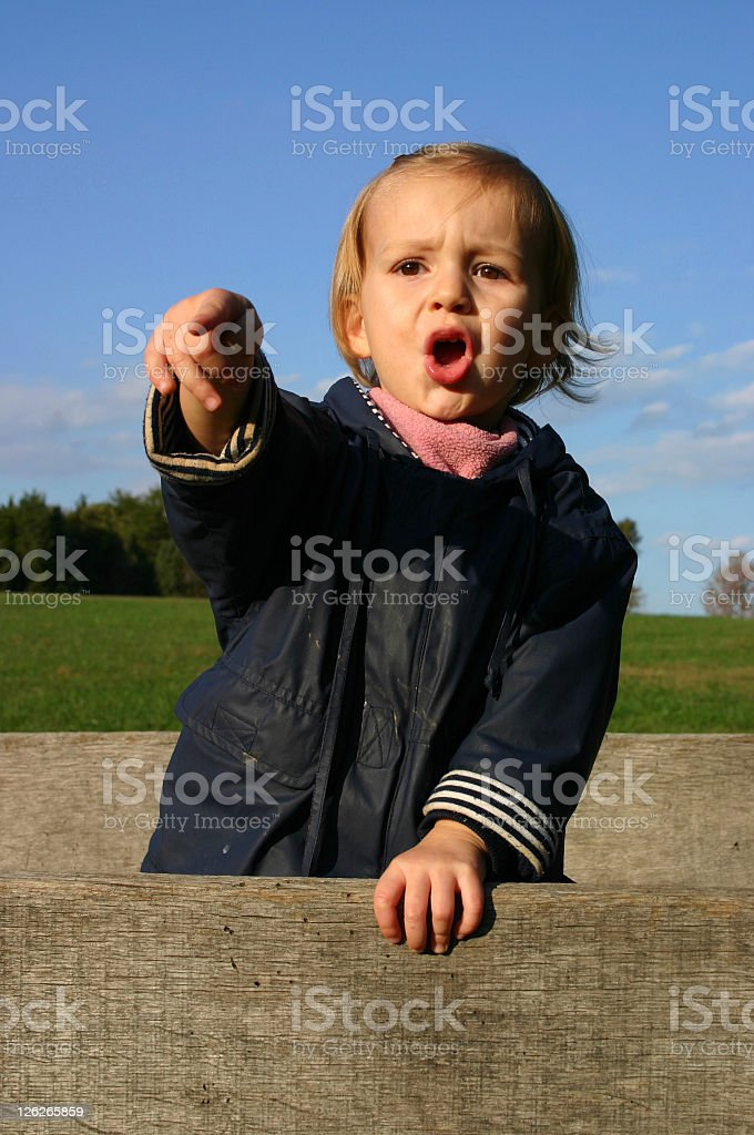 Young girl, standing on a hay wagon 'holding a speech' stock photo