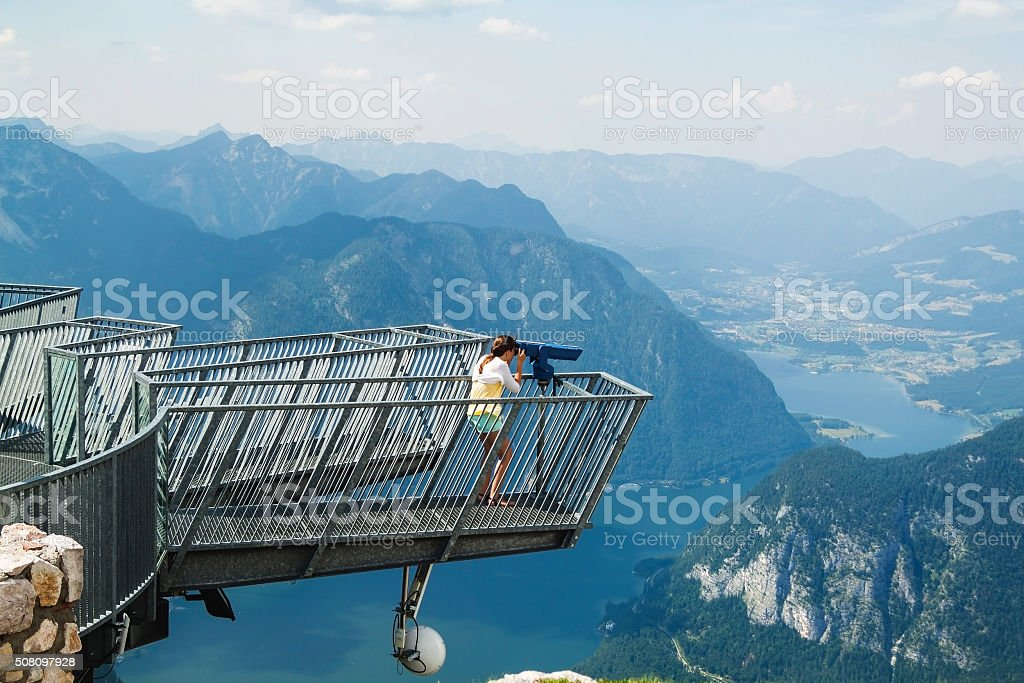 Young girl standing on the viewing platform Five Fingers.  Alps stock photo