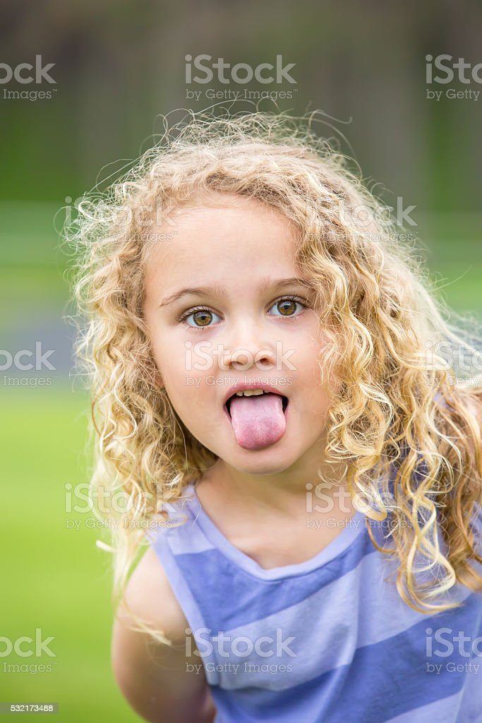 girls sticking tongue out