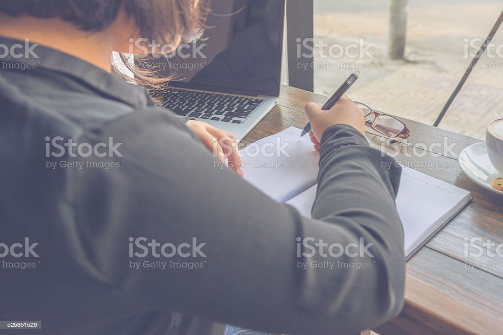 Young girl taking note some important points stock photo