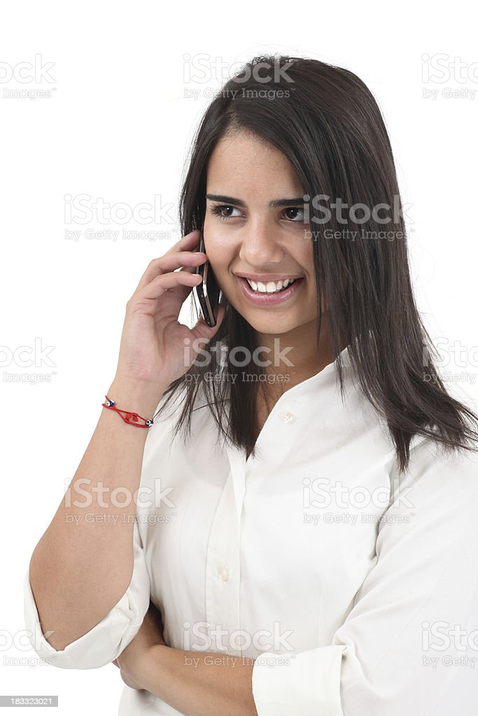 Young Girl Talking On The Cell Phone Smiling young woman talking on the cell phone. Isolated on white background. 20-29 Years Stock Photo