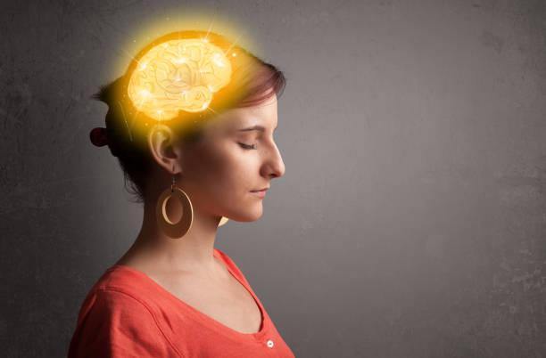 young girl thinking with glowing brain illustration - brain imagens e fotografias de stock
