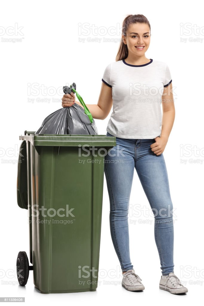 Young girl throwing out the garbage stock photo