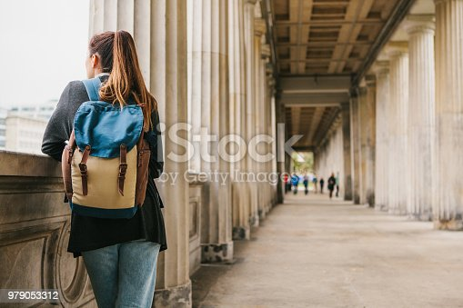 istock A young girl traveler or tourist or student with a backpack travels to Berdlin in Germany 979053312